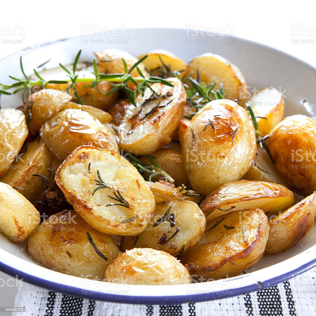 Dish with roasted potatoes and garnish stock photo