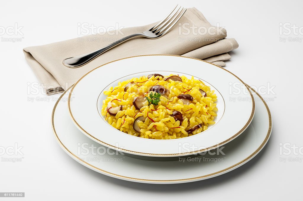 Dish with saffron risotto and mushrooms stock photo