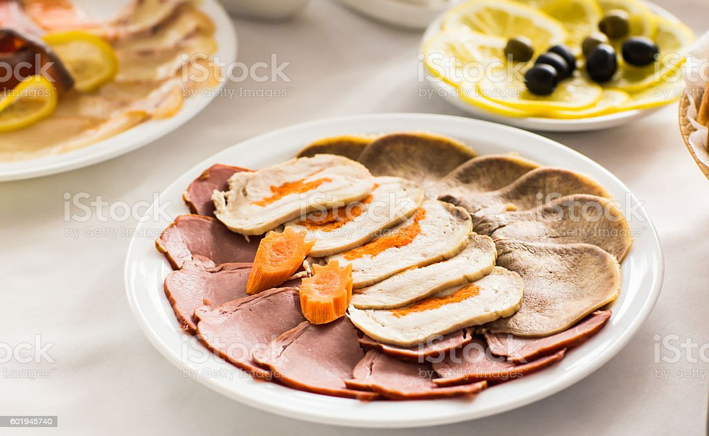 Dish with sliced meat products on the festive table stock photo