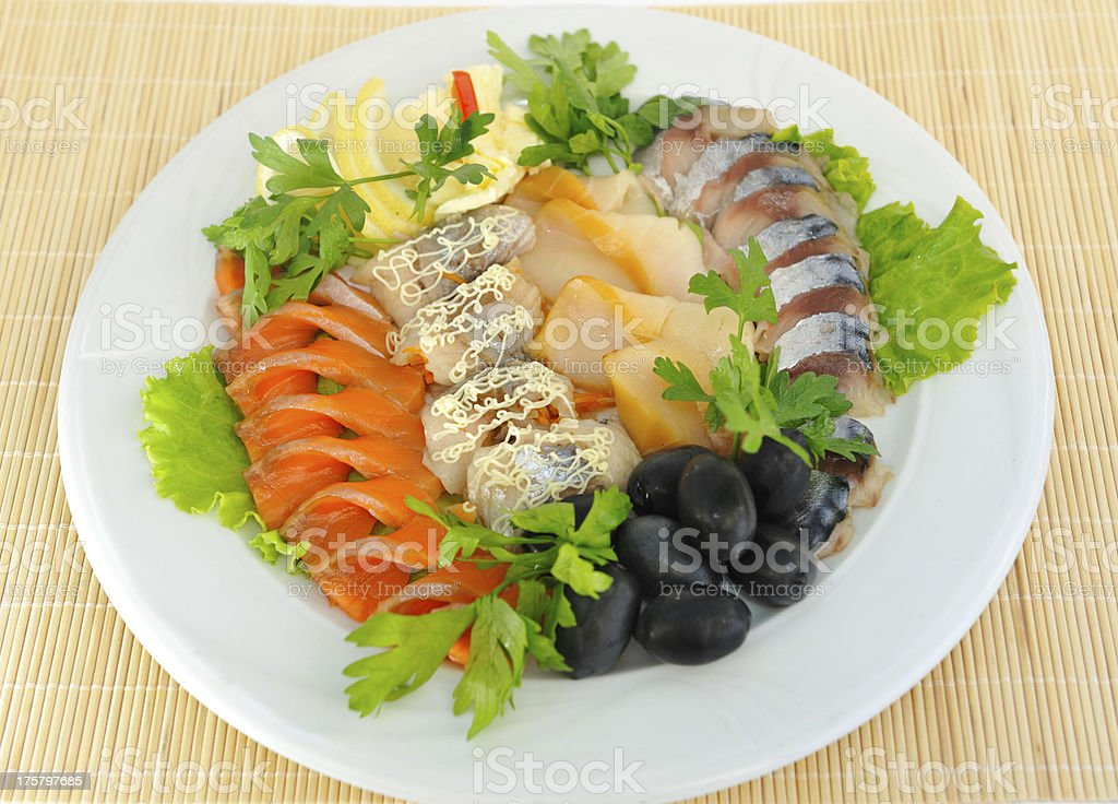 Dish with sliced ​​salmon, herring, sturgeon, decorated . royalty-free stock photo