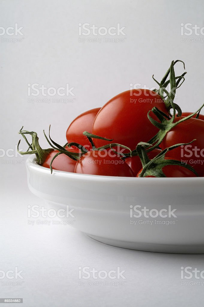 Dish with tomatoes (vertical) royalty-free stock photo