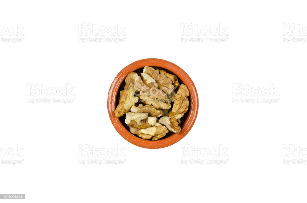 dish with walnuts isolated on a white background stock photo