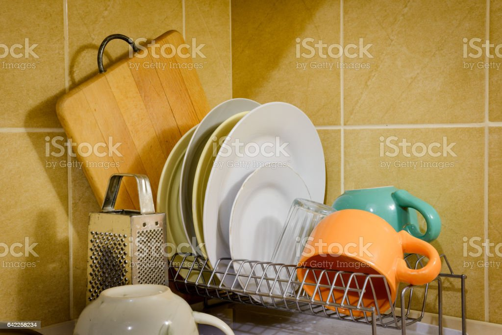 Dishes and Tableware Drying in Kitchen stock photo