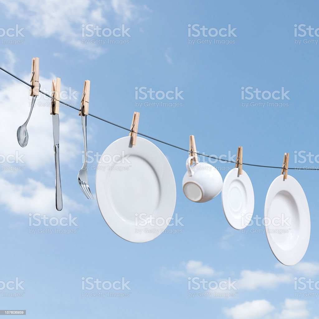 Dishes hung on a clothesline to dry royalty-free stock photo