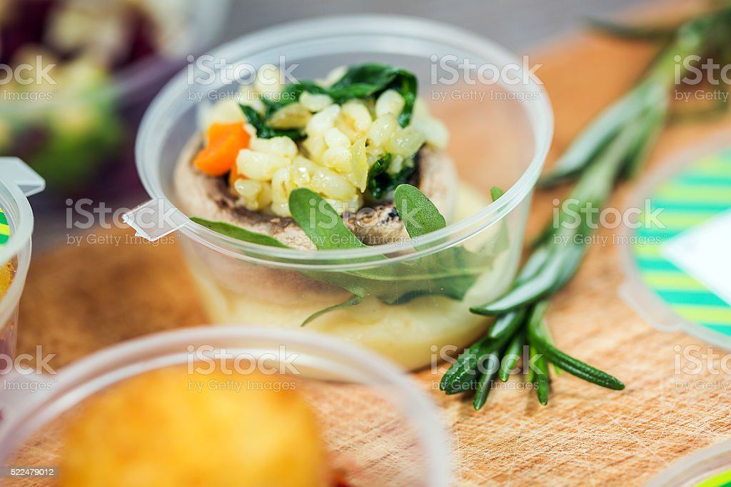 Dishes with fish and rice in plastic container stock photo