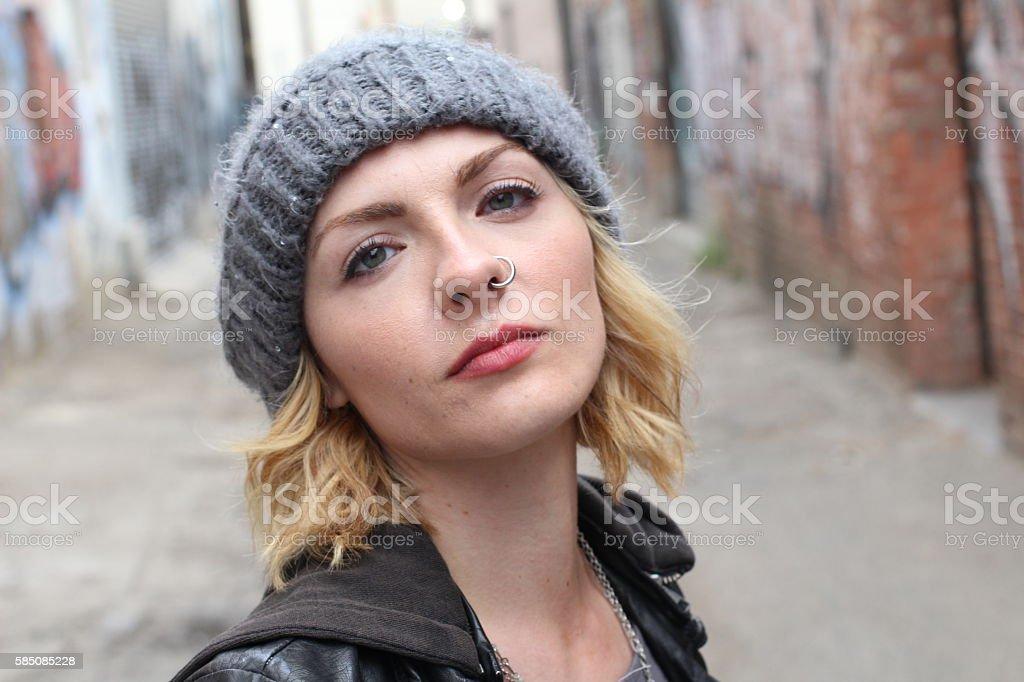 Disheveled pretty female high on drugs stock photo