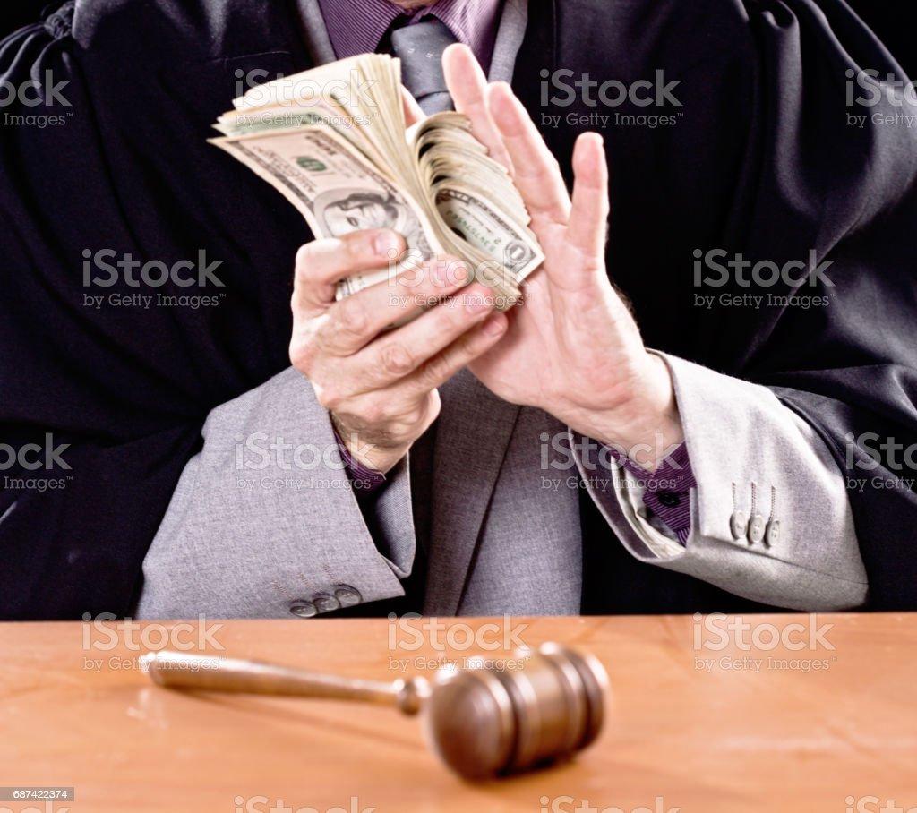 Dishonest judge counting bribe money. Cropped. stock photo