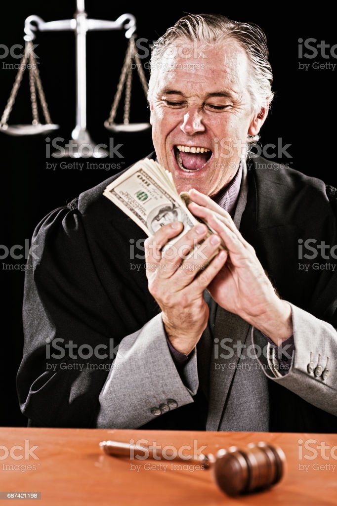 Dishonest judge gleefully counting bribe money stock photo