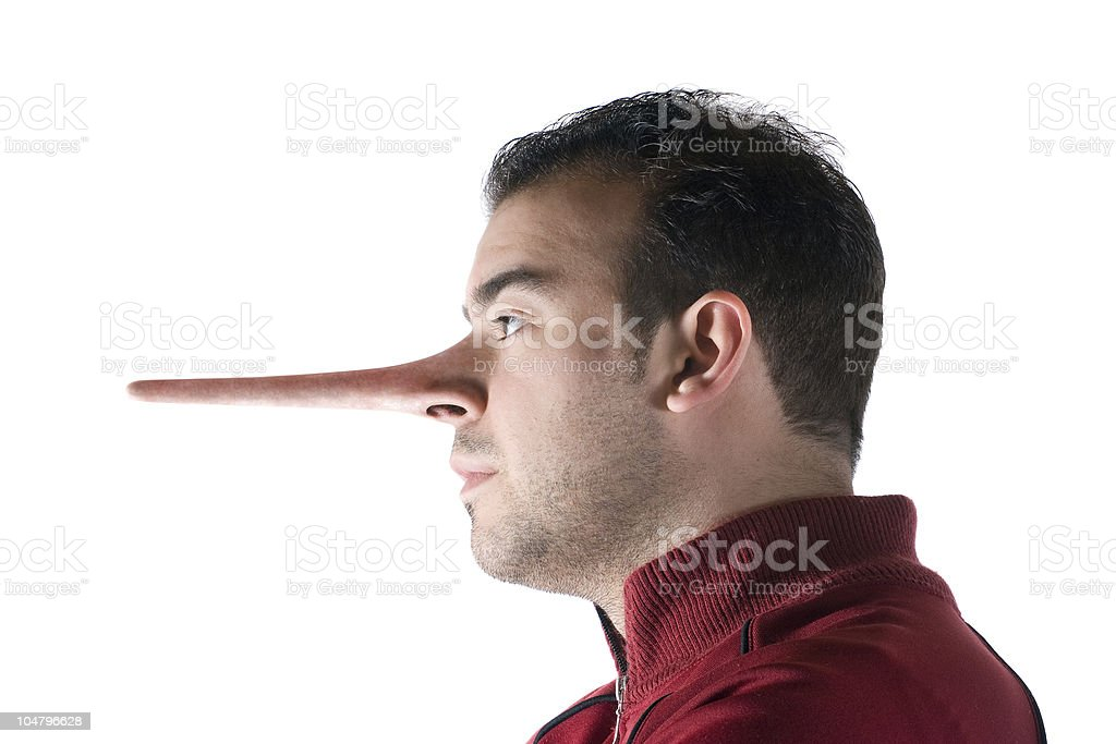 Dishonest man with long nose like Pinocchio's royalty-free stock photo
