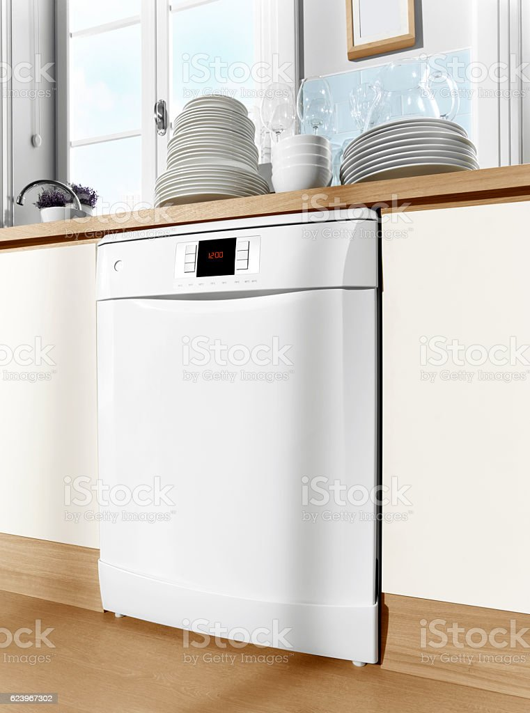 Dishwasher in modern kitchen stock photo