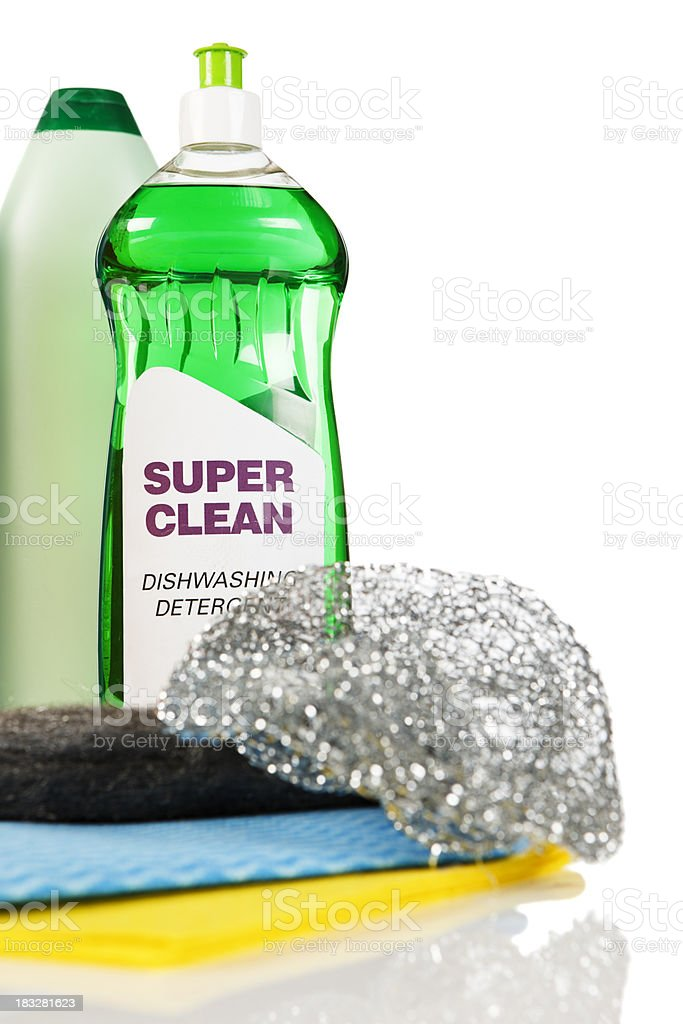 Dishwashing detergent and scourers on perspex against white stock photo