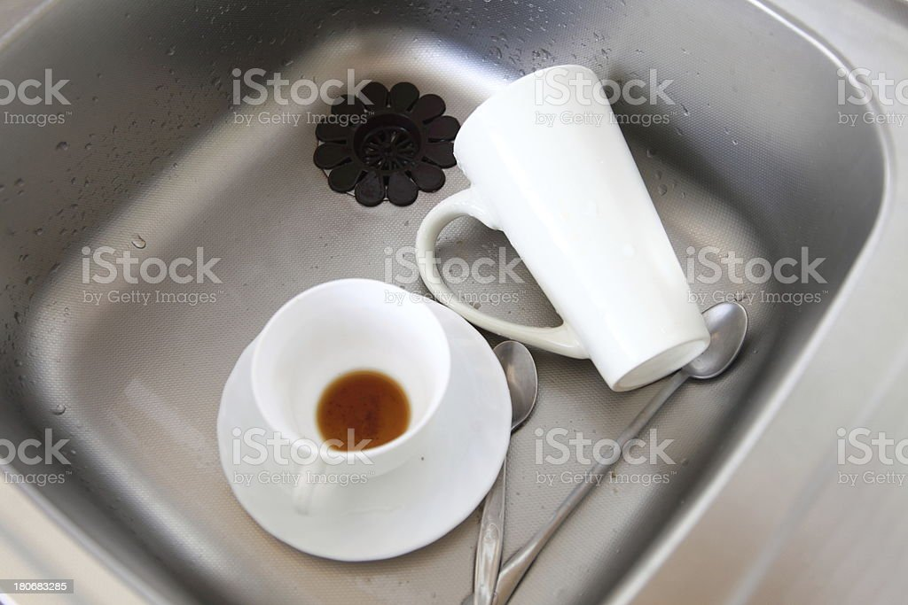 Dishwashing. White dishes in the kitchen sink. royalty-free stock photo