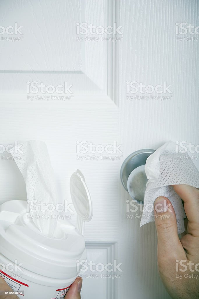 disinfecting door knob stock photo