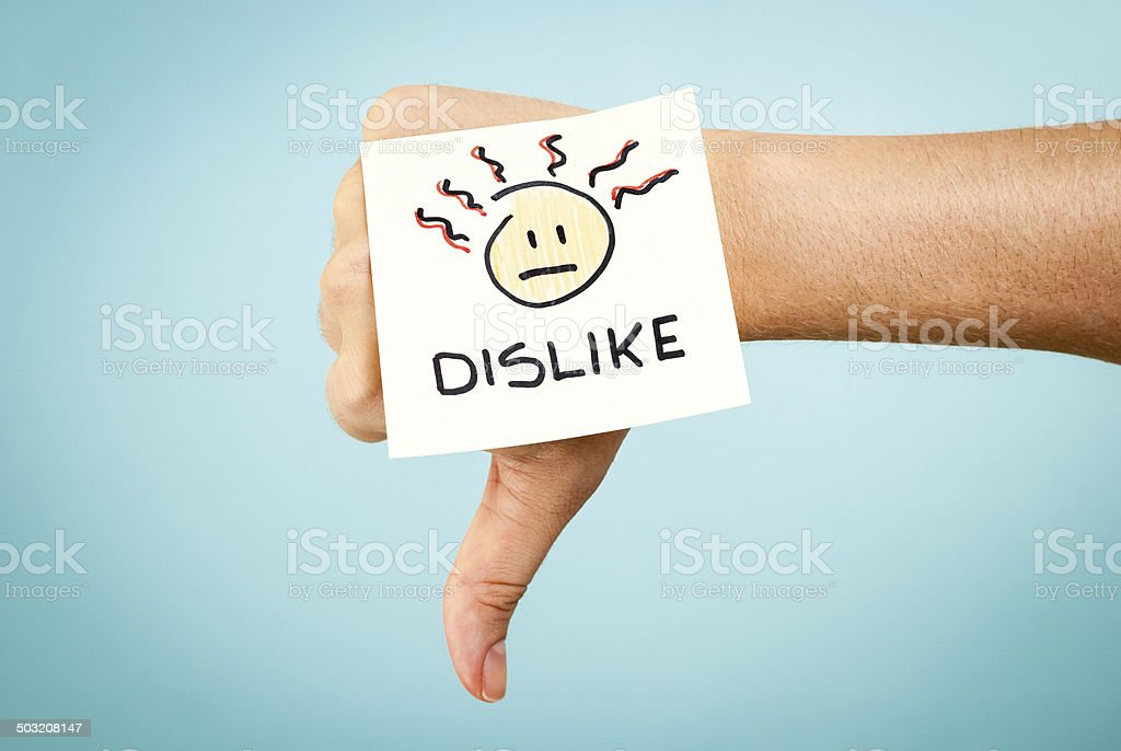 Dislike concept with hand on blue background stock photo