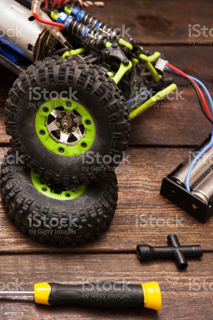 Dismantled broken Rc crawler model toy repair stock photo