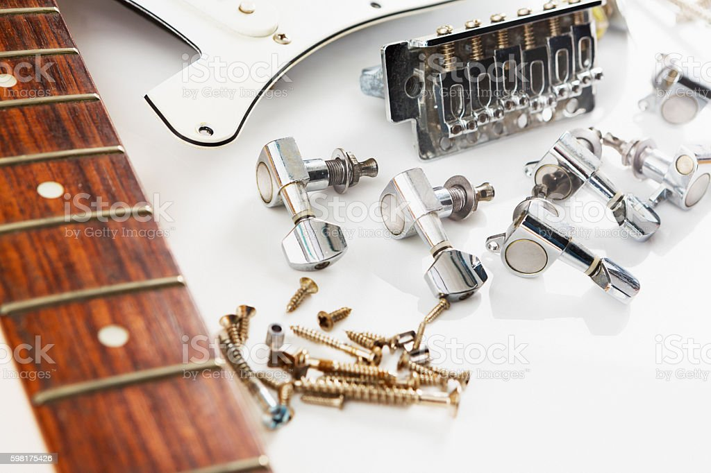 Dismantled electric guitar parts awaiting assembly stock photo