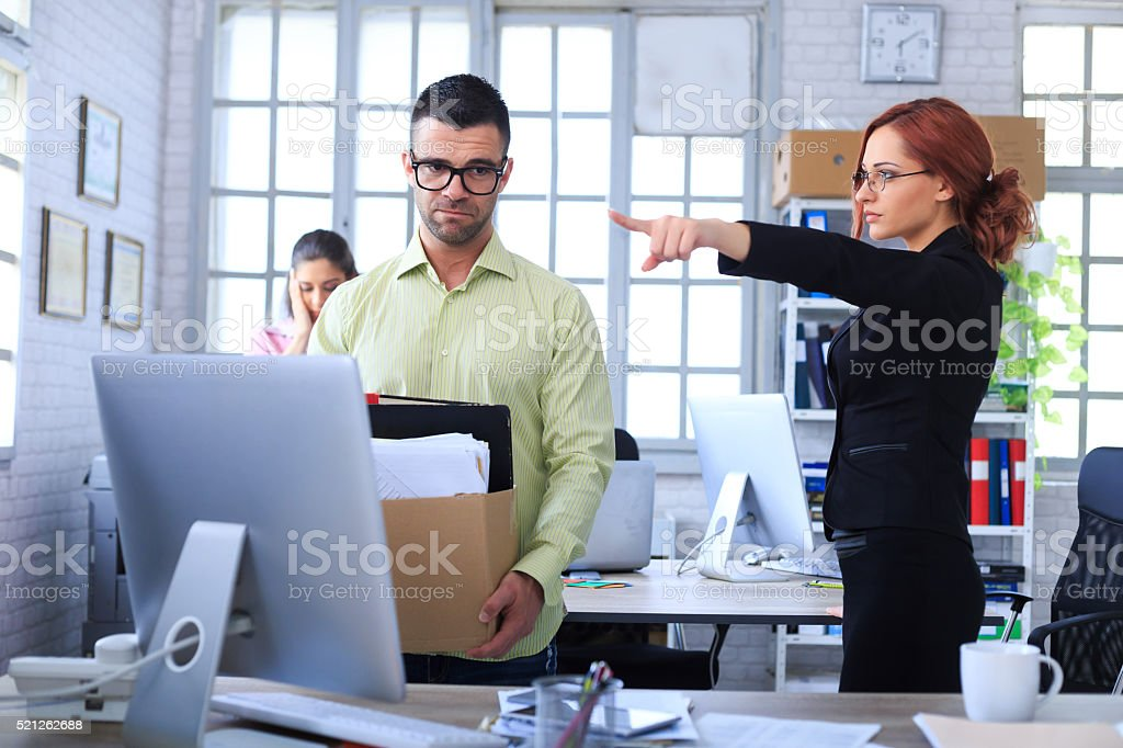Dismissed man leaving the office stock photo