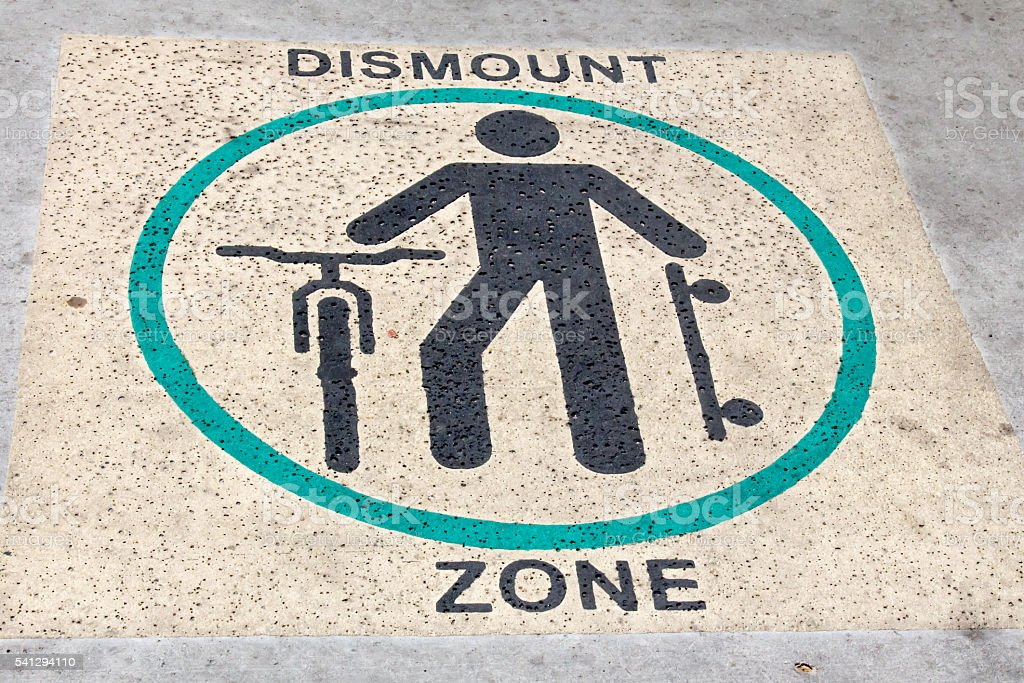 Dismount zone symbol on a sidewalk stock photo