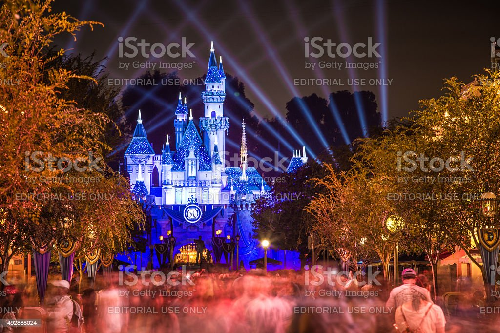 Disneyland 60th aniversary castle with people walking stock photo