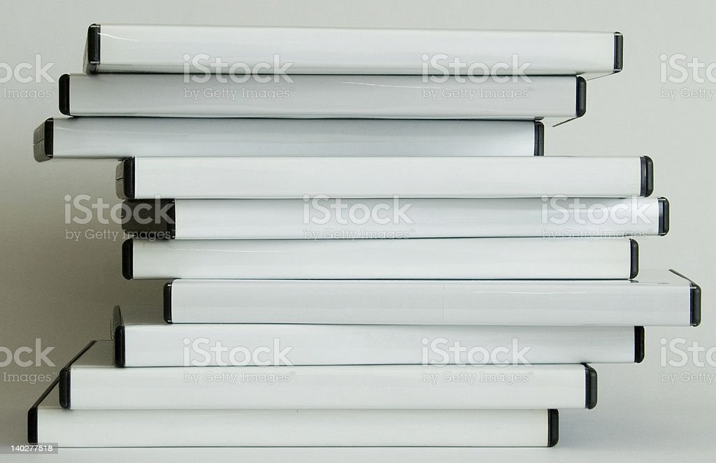 Disorganised stacked DVD's stock photo