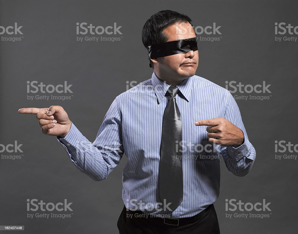 Disoriented blindfolded businessman stock photo