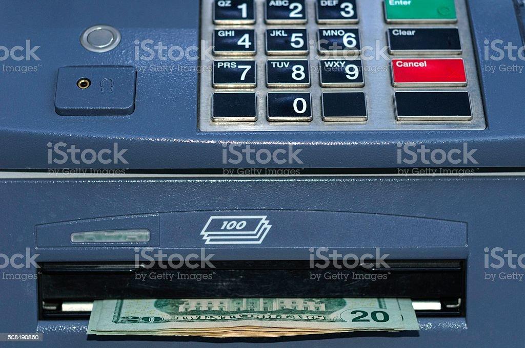 ATM Dispensing $20 Dollar Bills stock photo