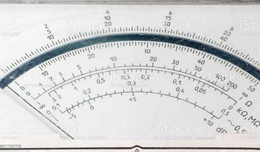 Display face of the old analog multimeter closeup stock photo