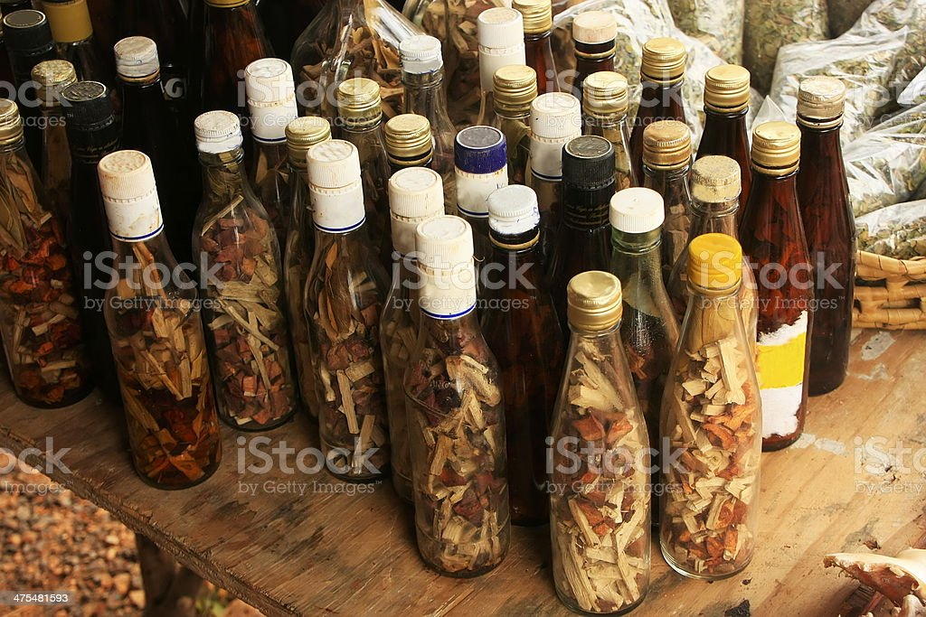 Display of bottles with 'Mama Juana' in small village royalty-free stock photo