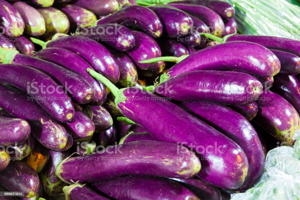 Display of eggplant for sale in traditional market stock photo