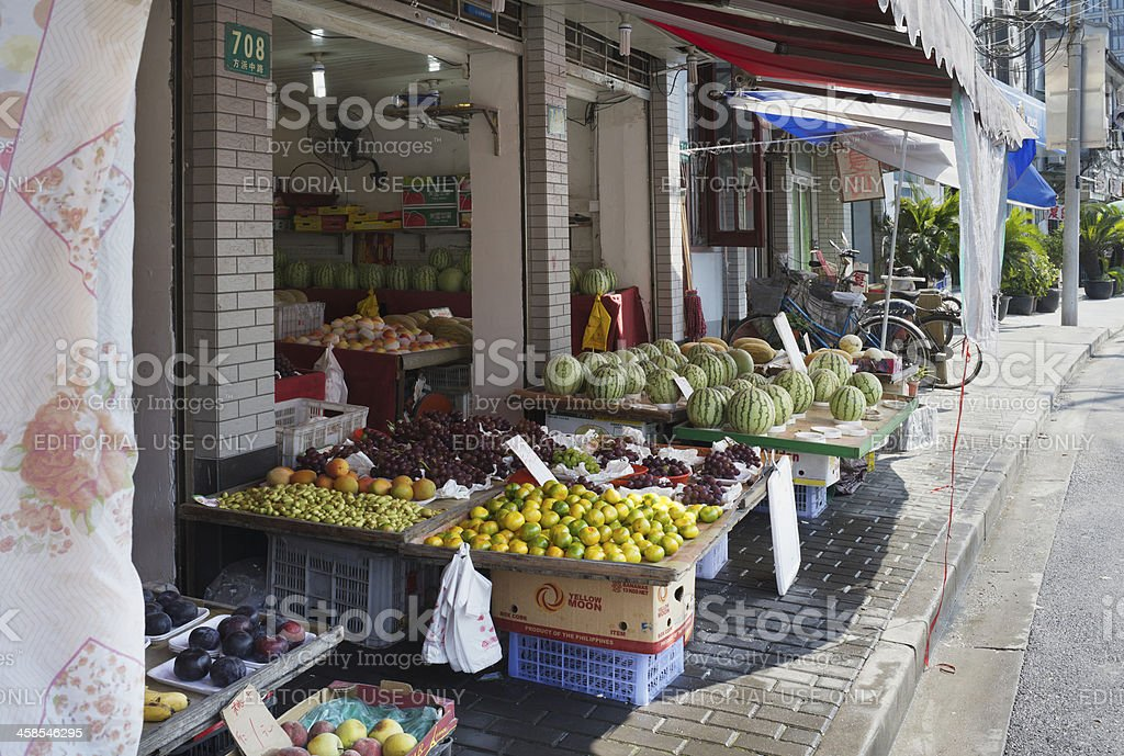 Display of fresh fruits at Shanghai Old Town fruit vendor royalty-free stock photo