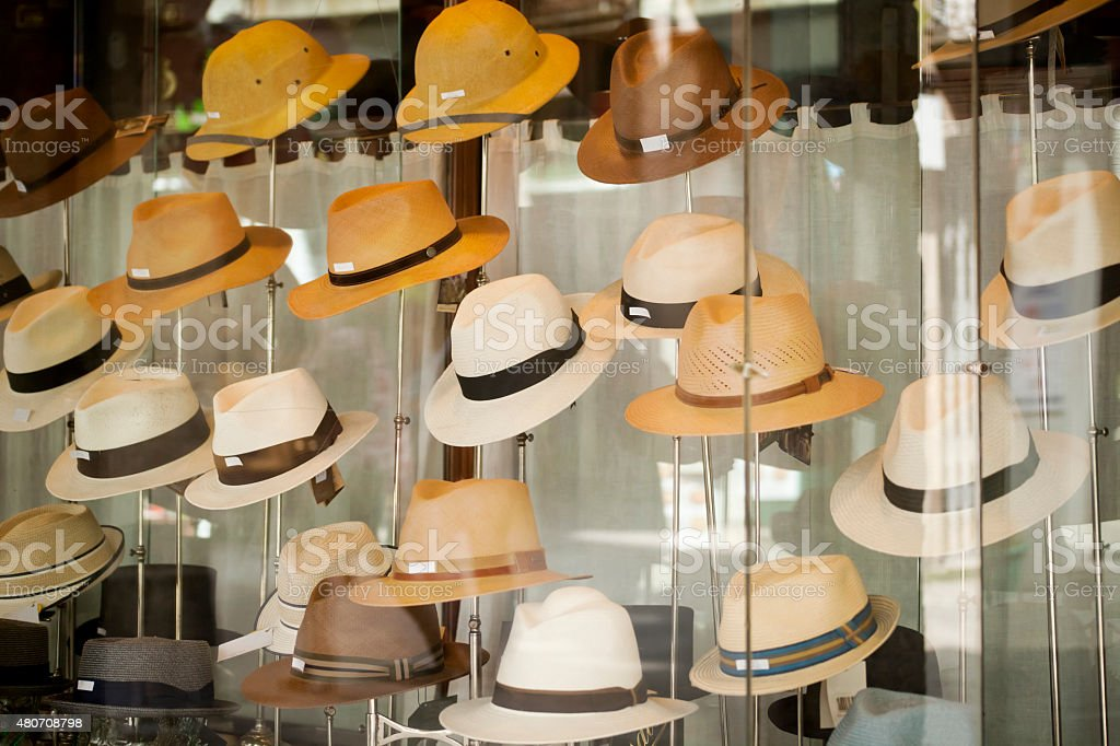 Display of hats in a  shop window stock photo