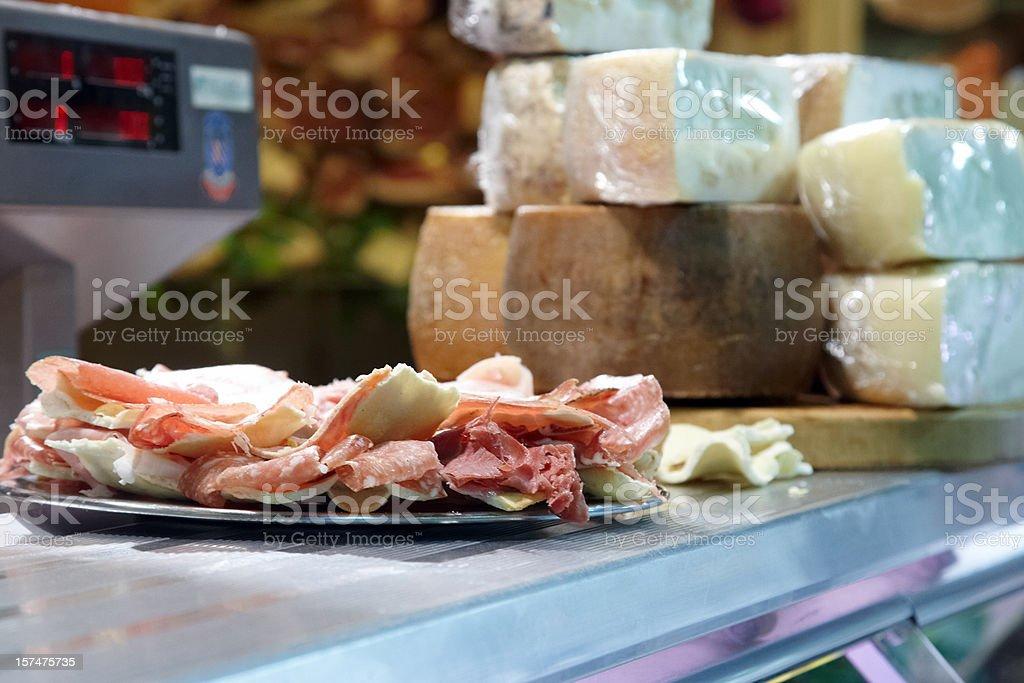 Display of parma hams and cheeses royalty-free stock photo