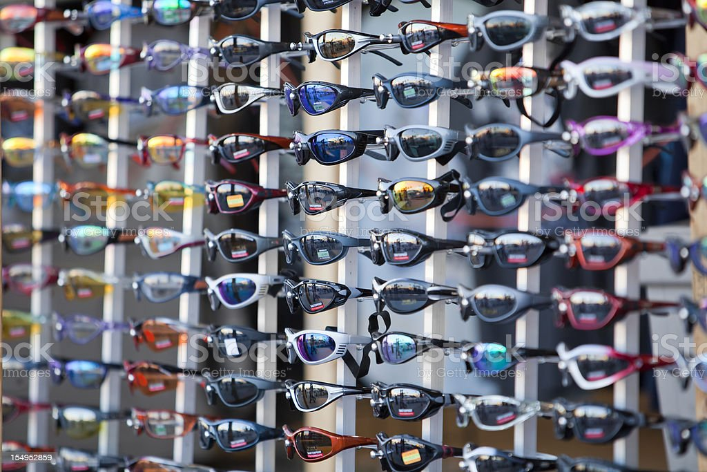 Display of sunglasses and goggles stock photo
