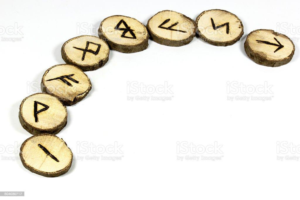 Display of Symbols on Handmade Wooden Runes stock photo