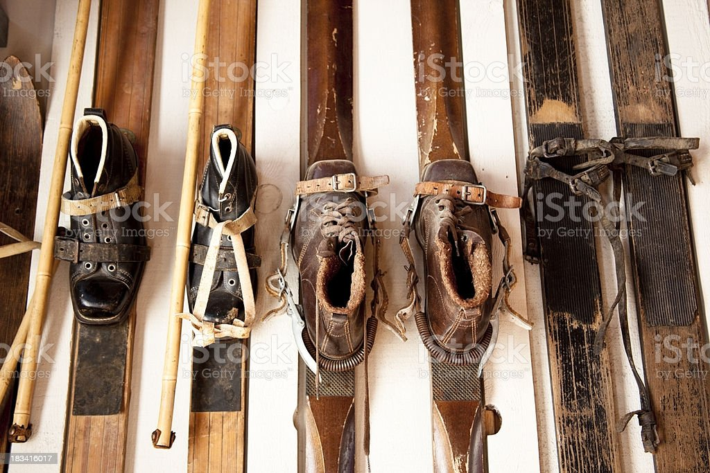 Display of very old skis and shoes stock photo