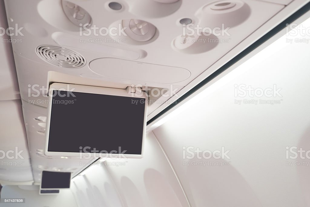 Display screen in the airplane stock photo