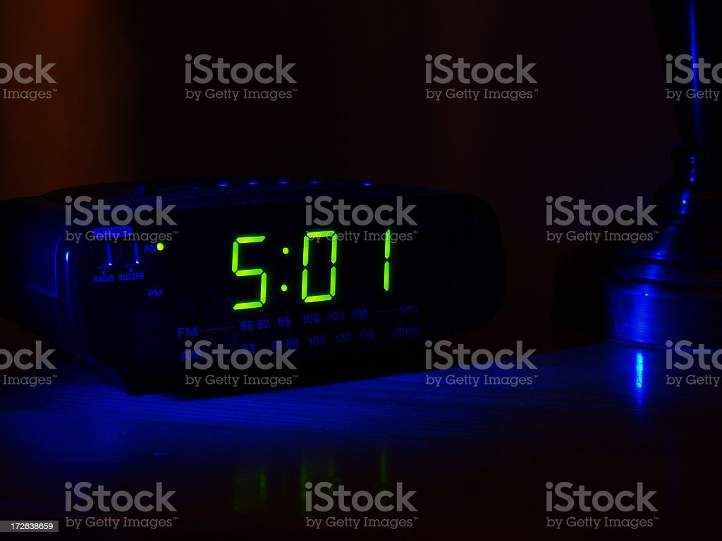 501 displayed on a clock in a dark room stock photo
