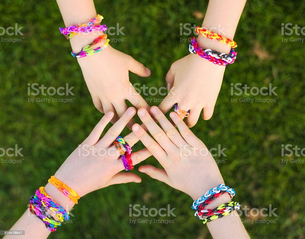 Displaying loom bracelets and rings stock photo