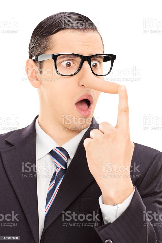 Displeased businessman looking at his long nose stock photo