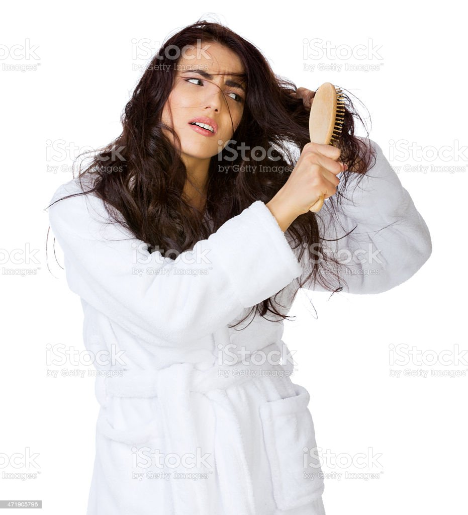 Displeased girl with tangled hairs stock photo