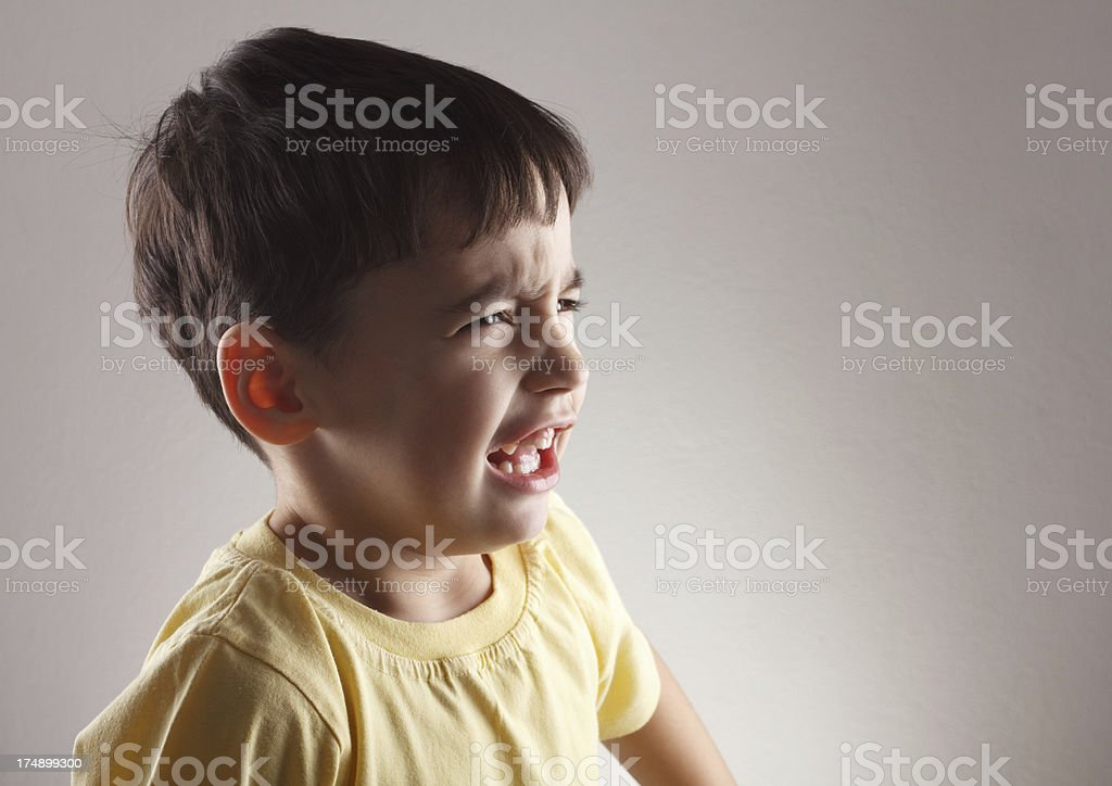 Displeased little boy royalty-free stock photo