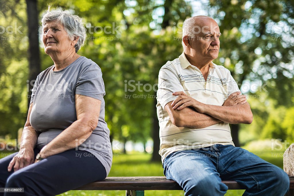 Displeased old couple having problems in their marriage. stock photo