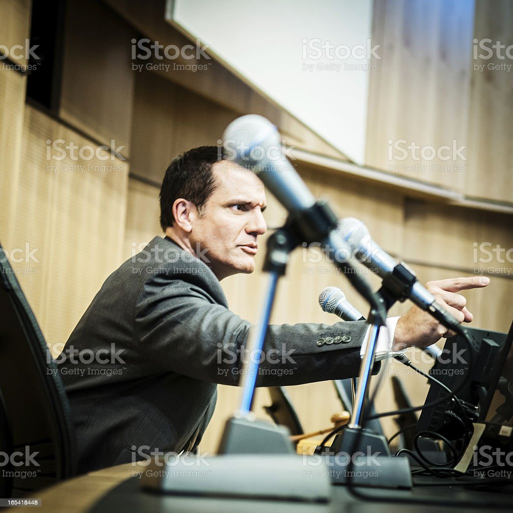 Displeased Politician at auditorium stock photo