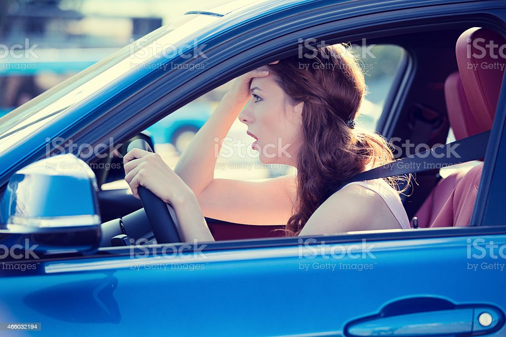 displeased stressed female car driver stock photo