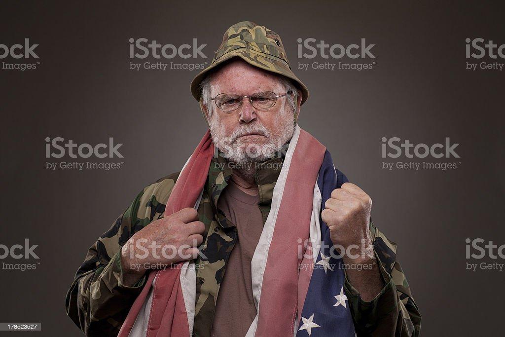 Displeased Vietnam Veteran with American flag stock photo