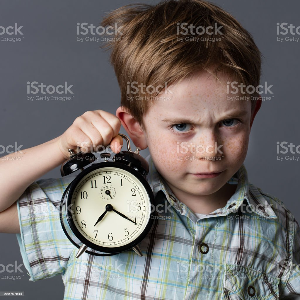 displeased young kid reproaching someone to be late, time concept stock photo