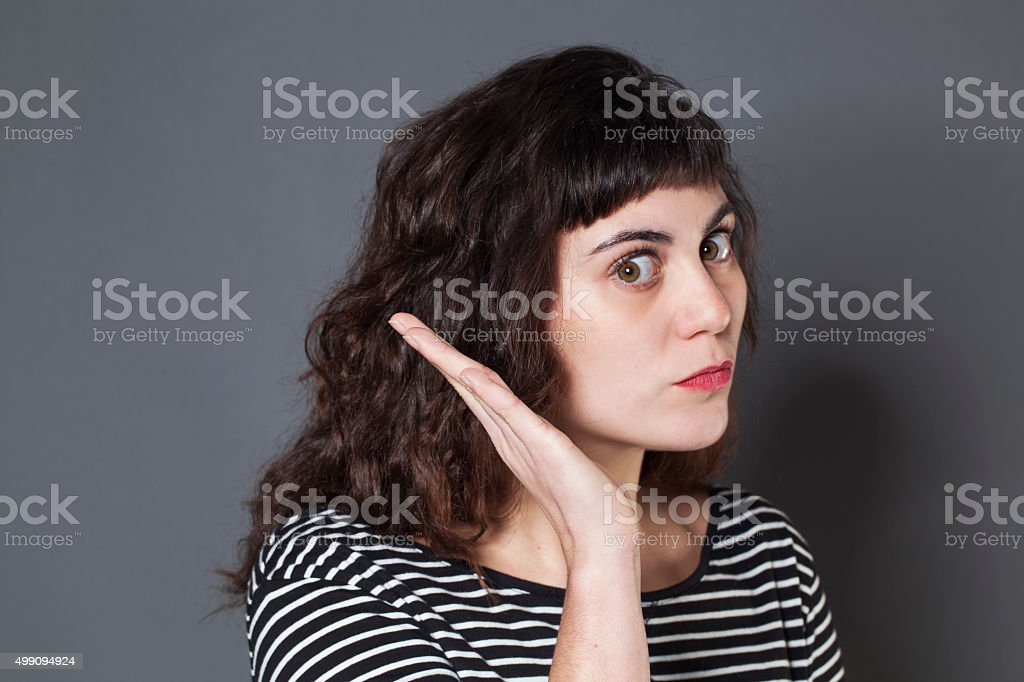 displeased young woman patronizing, giving a warning sign for education stock photo