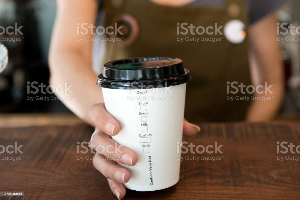 Disposable coffee cup stock photo