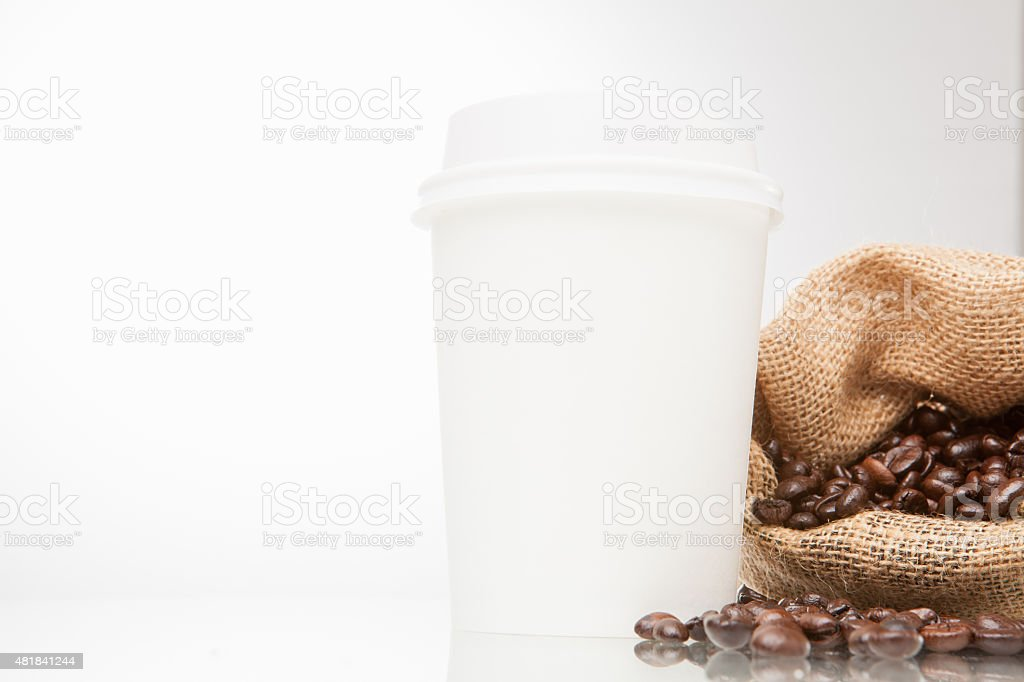 Disposable cup and bean coffee stock photo