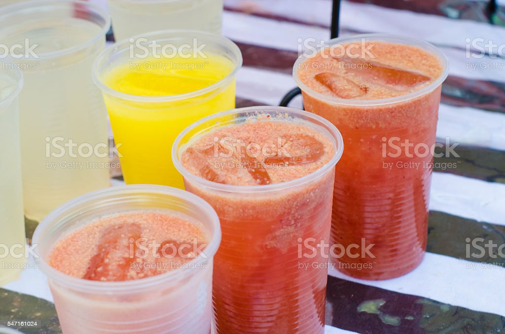 disposable cups with orange juice and strawberry stock photo